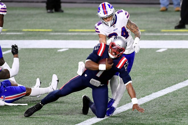 Patriots quarterback Cam Newton gets into the end zone for a touchdown in front of Bills cornerback Taron Johnson during the second quarter Monday night at Gillette Stadium.