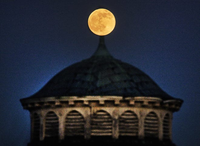 """WORCESTER - A full """"cool"""" moon rises above Hooper Turret, a round stone building, on the property of the former Worcester State Hospital early Tuesday evening. Known as the Worcester Insane Asylum, the hospital opened in January of 1833."""