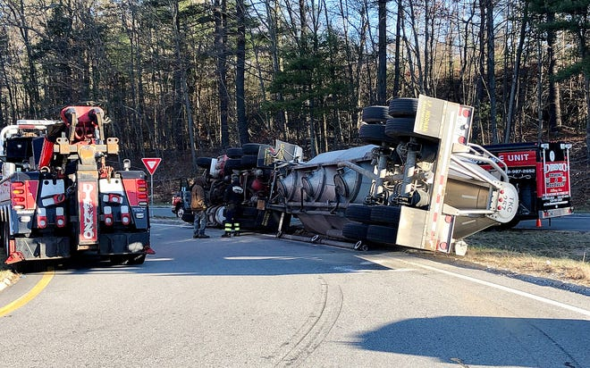 WEBSTER - The tractor-trailer overturned early Tuesday on the ramp leading to I-395.