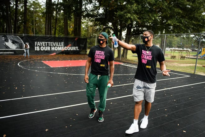 Fayetteville native Dennis Smith Jr. (right), a guard for the New York Knicks, shows Winston-Salem native Chris Paul, a guard for the Phoenix Suns, the basketball court at Smith Recreation Center during the pair's visit to Fayetteville in October of 2020.