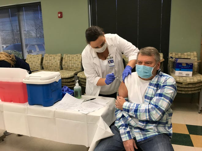Survival Flight pilot Don Wilson received one of the first injections of the Moderna COVID-19 vaccine at the Etowah County Health Department Tuesday.