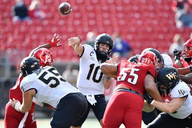 Wake Forest quarterback Sam Hartman finds space to fire off a pass against Louisville earlier this month.