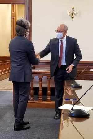 Michael J. Ernest recently took the oath of office before outgoing Judge Edward Emmett O'Farrell. Pictured, from left: Edward Emmett O'Farrell and Michael J. Ernest.
