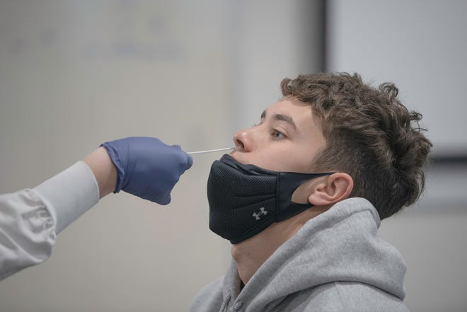 Colorado State University Pueblo student athlete David Simental  sits through a COVID-19 test on Monday December 28, 2020.