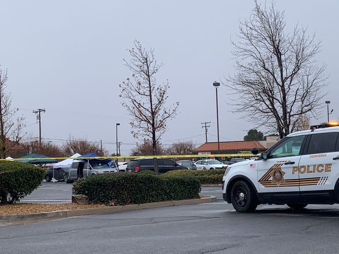 Authorities investigate a deputy-involved shooting in the parking lot of a Stater Bros. Markets grocery store in Hesperia on Monday afternoon, Dec. 28, 2020.