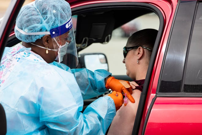 The Corpus Christi Ð Nueces County Public Health District hosts a drive-thru COVID-19 vaccination event for residents part of Phase 1A Tier 1 or 2 and residents 65 and older on at the Richard M. Borchard Regional Fairgrounds on Tuesday, Dec. 29, 2020.