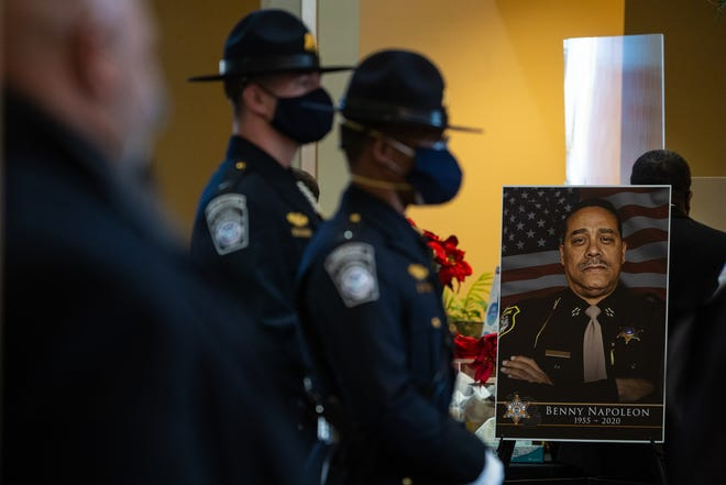 A photo of the late Wayne County Sheriff Benny Napoleon sits on display during his visitation service at Greater Grace Temple in Detroit on Tuesday, December 29, 2020. Napoleon passed away on December 17, 2020 after a weeks-long battle with COVID-19.