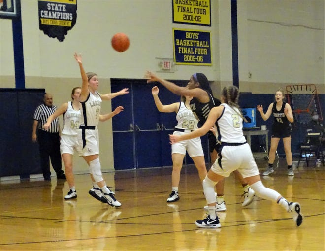 Lancaster sophomore Kara Weaver attempts to deflect a Pickerington North pass during Tuesday's non-conference game. The Lady Gales fell short, 47-33.
