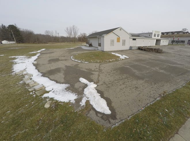 The former Holkins Lumber building, shown Tuesday, Dec. 29, 2020, which now houses The Hive teen center, sits on a city block that is for sale in Howell.