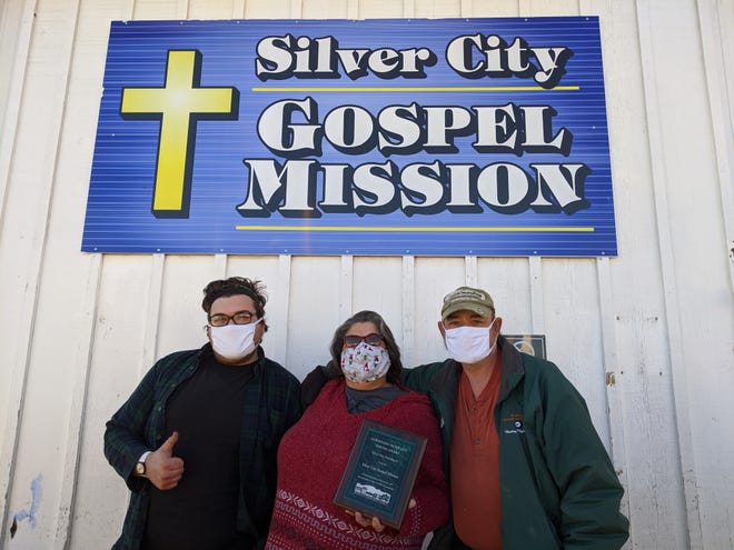 James Wagner, from left, Amy Wagner and James Gase of the Silver City Gospel Mission.