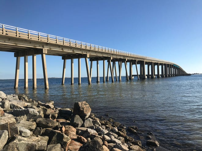 A handful of Santa Rosa County residents seek to have the Navarre Bridge connecting Highway 98 with Navarre Beach renamed to honor President Trump.