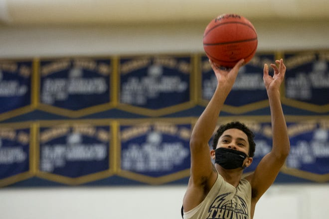 Junior Daylyn Martin, 16, takes a shot during practice with the basketball team at Desert Vista High School in Phoenix, Ariz. on on Dec. 28, 2020.