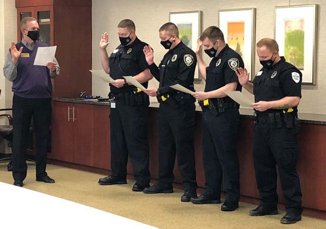 Craig Kinyon, the president and CEO of Reid Health, swears in Officers Jeramiah Lawson (from left), Jeremy Hicks, Dillon Pitcher and David Jones to the Reid Health Police Department.