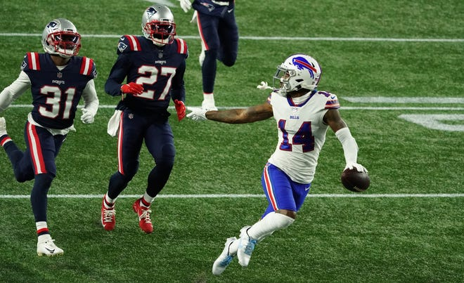 Buffalo Bills wide receiver Stefon Diggs (right) runs the ball for a touchdown against New England Patriots cornerback J.C. Jackson and defensive back Jonathan Jones (left) in the Patriots' loss to the Bills on Monday.