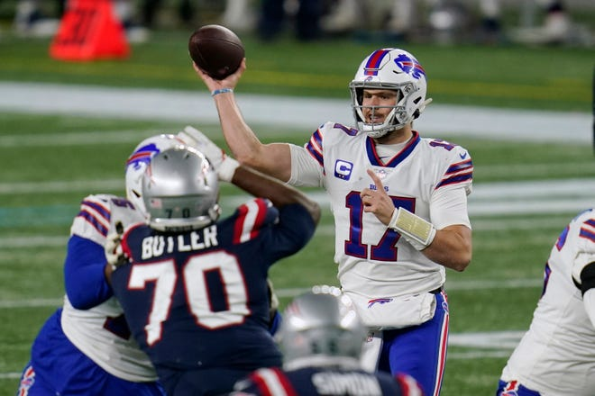 Bills quarterback Josh Allen, passing under pressure from Patriots defensive lineman Adam Butler in December, was a lower-rated recruit out of high school than his backup.