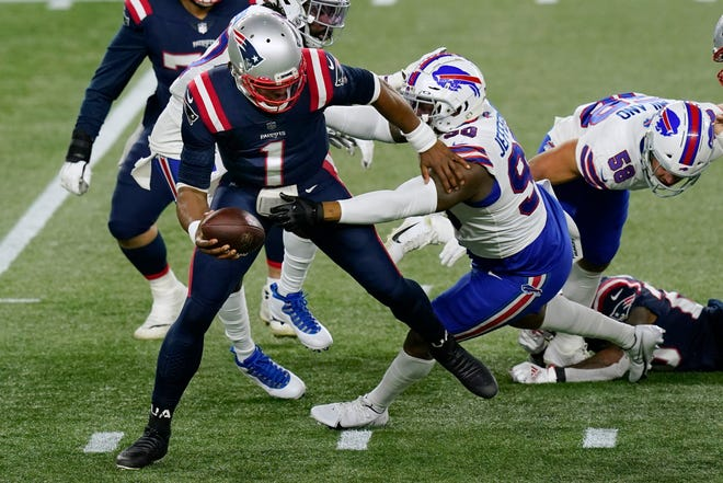 Bills defensive tackle Quinton Jefferson (right) sacks Patriots quarterback Cam Newton in the first half of New England's 38-9 loss to Buffalo Monday night, in Foxborough.