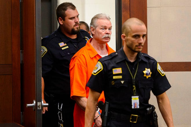FILE - In this Aug. 5, 2019, file photo, Douglas Lovell is escorted into the courtroom for an evidentiary hearing in Ogden, Utah. The Church of Jesus Christ of Latter-day Saints says it didn't improperly meddle in the 2015 trial of death row inmate Lovell when it laid out ground rules for what local church leaders could say before they testified as character witnesses for the man. (Trent Nelson /The Salt Lake Tribune, via AP, Pool, File)