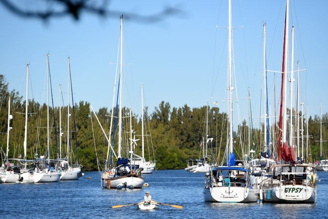 """A seasonal boater makes their way back to their boat moored at the Vero Beach Municipal Marina on Monday, Feb. 3, 2020, during peak operations for the winter months. """"We've been going at full-tilt since October,"""" said Sean Collins, dock master at the marina. Once we get over the hump of hurricane season, things start to pick up around here."""" The marina includes 100 wet slips, 55 boats in its rack storage building and 57 mooring buoys for transient boaters. """"And it's not just the money that comes in from dock fees and fuel, but also the money spent around town that really helps our town financially."""""""