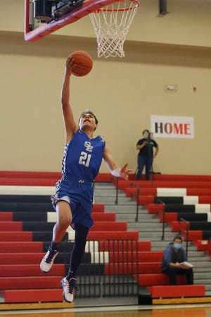 San Elizario's Jay Hernandez takes a shot during the game against Tornillo Tuesday, Dec. 29, at Tornillo High School in El Paso.