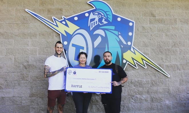 From left to right: MTV reality star Travis Ross, Accelerated Charter High School Principal Wendi Powell, and Joseph Cabello of Body Art Gallery. Cabello informed  Ross about the Tulare school, so Ross decided to help students.