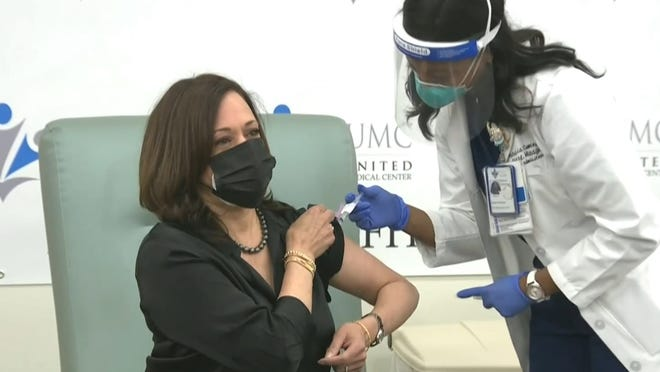 Vice President-elect Kamala Harris received her COVID-19 vaccine along with her husband, Doug Emhoff.