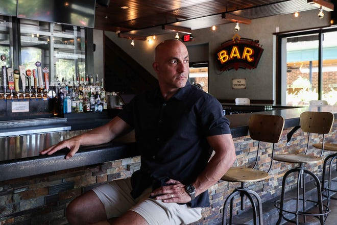 Dogwood co-owner Jason Carrier says both locations of his bar will be open for business as usual on New Year's Eve, despite threat of a fine from the city. [AMERICAN-STATESMAN FILE]