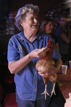 Ginny Kalmbach with Cissy the chicken after a round of Chicken (expletive) Bingo at Ginny's Little Longhorn Saloon in 2008.