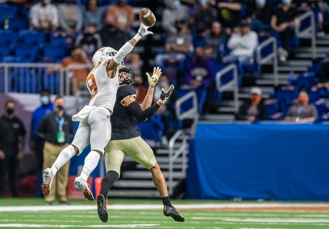 """Texas cornerback Josh Thompson, shown breaking up a pass in last season's Alamo Bowl victory over Colorado, raves about the new coaching staff's demand for accountability and discipline. """"I mean, every team needs that to be successful,"""" he said Tuesday."""