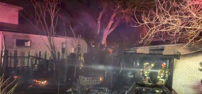 Austin fire crews are fighting a fire that has spread to two homes in East Austin, officials said Tuesday evening.