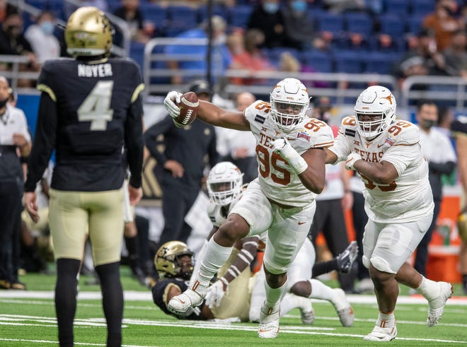 Texas defensive lineman Alfred Collins celebrates after an interception against Colorado in the Longhorns' 55-23 win in the Alamo Bowl in December. Collins could be headed for a breakout season as a sophomore.