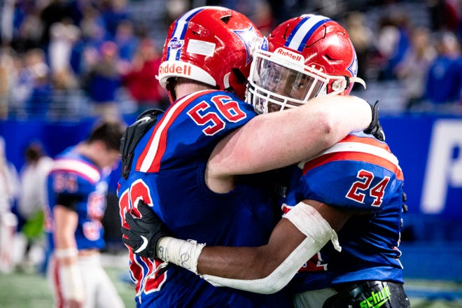Jefferson's Colton Steele (56) and Jefferson's Malaki Starks (24) embrace after their loss at the end of the 2020 Class 4A GHSA State Championship football game between the Marist War Eagles and the Jefferson Dragons at Center Parc Stadium in Atlanta, Ga. on Tuesday, Dec. 29, 2020. Both Marist and Jefferson entered the final game of the 2020 season undefeated, but Marist came out on top, winning the state championship game 30-14.