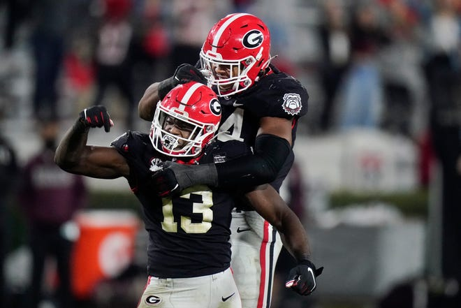 Georgia linebacker Azeez Ojulari (13) celebrates with defensive lineman Travon Walker (44) after a sack during the second half of an NCAA college football game against Mississippi State, Saturday, Nov. 21, 2020, in Athens, Ga. (AP Photo/Brynn Anderson)