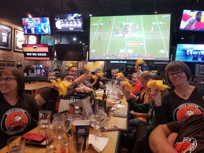 The Canton Browns Backers meet at The Winking Lizard, 5710 Fulton Road, NW. Here, they hold penalty flags they throw when umpires make bad calls during games.