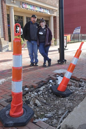Chameleon Café owners Mike and Adria Buzek brace for construction work on Main Street in downtown Akron between Mill and Market streets.