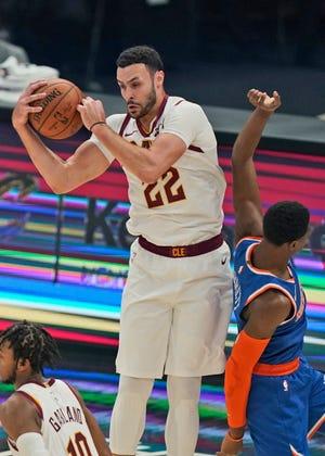 Cavaliers' Larry Nance Jr. (22) grabs a rebound ahead of New York Knicks' RJ Barrett (9) in the first half of an NBA basketball game, Tuesday, Dec. 29, 2020, in Cleveland. [Tony Dejak/Associated Press]