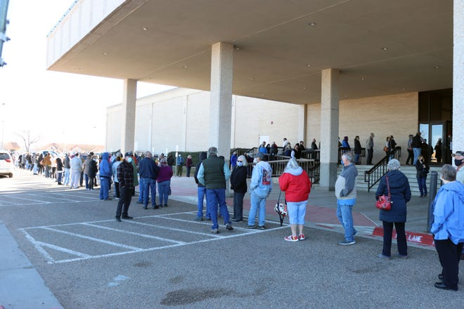 Hundreds of people line up outside the Amarillo Civic Center as a crowd gathers Wednesday, Dec. 30, for the COVID-19 vaccine. Per the City of Amarillo, Jan. 4 through Jan. 8 from 9 a.m. to 5 p.m. immunizations will be offered at the North Exhibit Hall - Entrance 3. Saturday, Jan. 9 vaccination times are from 9 a.m. to 2 p.m.