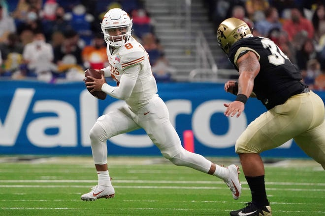 Dec 29, 2020; San Antonio, TX, USA; Texas Longhorns quarterback Casey Thompson (8) is pursued by Colorado Buffaloes defensive end Mustafa Johnson (34) in the second half during the Alamo Bowl at the Alamodome.