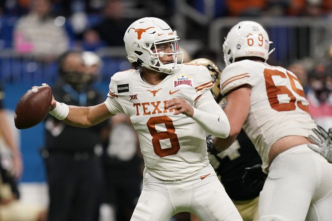 Texas quarterback Casey Thompson looks for a receiver during his breakout second half of the Alamo Bowl win over Colorado last season. He and Hudson Card are battling for the starting position now that Sam Ehlinger has moved on.