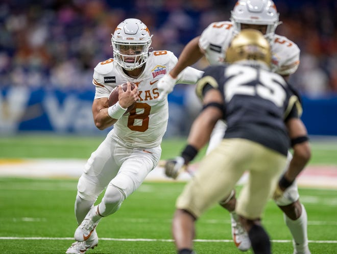 Texas quarterback Casey Thompson looks for room to run against Colorado during Tuesday night's 55-23 Alamo Bowl win. The backup played most of the second half with the game on the line.