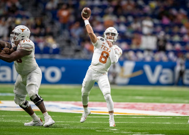 Texas Longhorns quarterback Casey Thompson passes the ball against the Colorado Buffaloes during the Valero Alamo Bowl at the Alamodome on Tuesday in San Antonio. Thompson filled in for an injured Sam Ehlinger and though he completed just eight passes, half of them went for touchdowns.