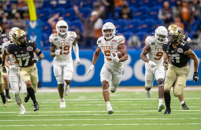 Texas running back Bijan Robinson breaks out for a big run during the Longhorns' 55-23 win over Colorado in the Alamo Bowl on Dec. 29. Robinson should be the featured back in new Texas coach Steve Sarkisian's offense in 2021.