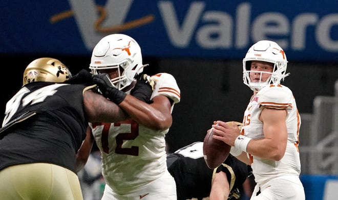 Texas quarterback Sam Ehlinger throws a pass during the first half of the Longhorns' 55-23 win over Colorado in the Alamo Bowl.