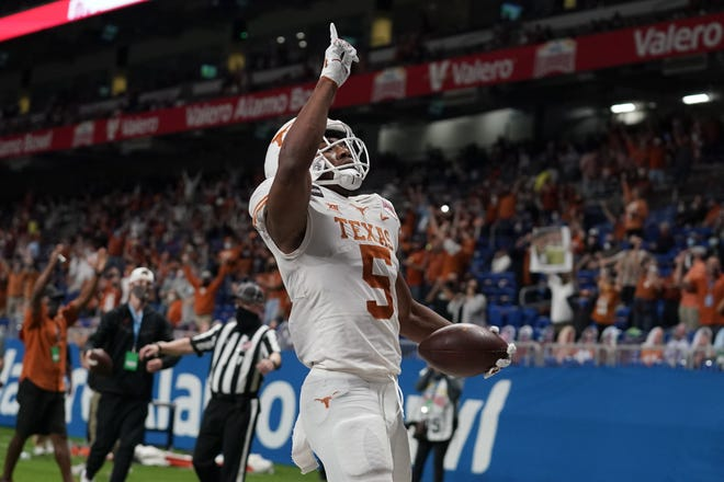 Texas running back Bijan Robinson celebrates a first-half touchdown in the Longhorns' 55-23 Alamo Bowl win over Colorado. The freshman rushed for 183 yards and scored three touchdowns.