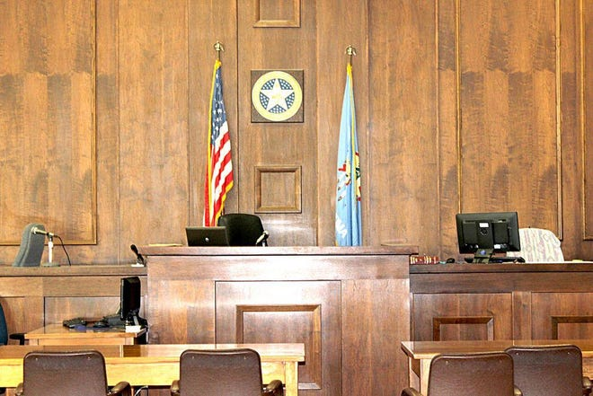 A photo of an empty courtroom at the Carter County Courthouse.