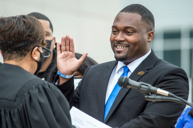 New District 1 Commissioner Jordan Johnson, right, takes the oath of office from State Court Judge Kellie McIntyre on Wednesday morning outside the Municipal Building in Augusta.