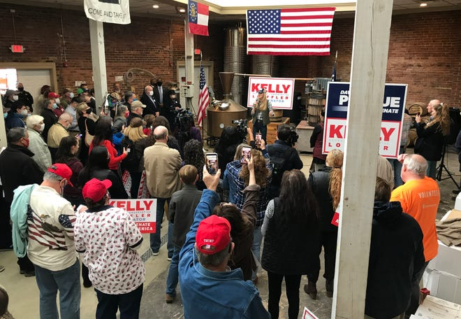 """Georgia Republican U.S. Sen. Kelly Loeffler talks to supporters during her """"Senate Firewall"""" rally at the 2nd City Distilling Company in Augusta, Ga., Wednesday afternoon December 30, 2020."""