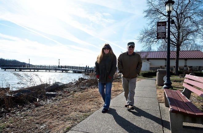 Sara Keech and her husband Patrick, of Northampton, stroll along Waterfront Park in Bristol Borough on Wednesday. A $1 million state grant will aid in a renovation of the park and adjacent parking lot.