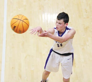 Clayton Holley lets go an outside shot for Wesleyan Christian School. (Mike Tupa/Examiner-Enterprise)