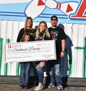The Shamrock Bowling team had a T-shirt fundraiser after their home bowling alley caught fire in mid-November. They were able to sell over 500 T-shirts to help AJ and Becky Corder, owners of Chestnut Lanes. The bowling team presented the Corders with a check from their fundraiser and also gave a donation from their organization.