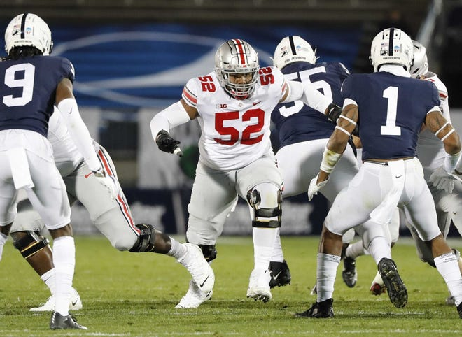Wyatt Davis (52) expected to spend the fall getting ready for the NFL draft. But when the Big Ten reversed its decision to cancel fall football, the junior guard didn't hesitate to rejoin his Ohio State teammates.